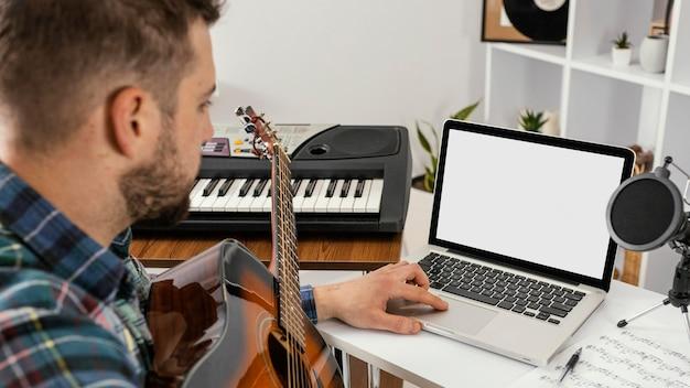 Close-up man recording a song