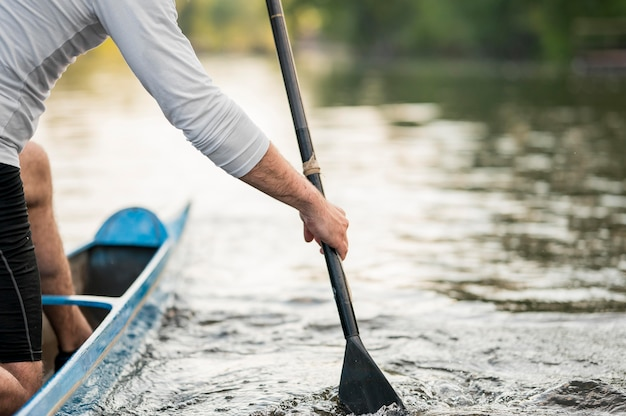 Close-up man rowing