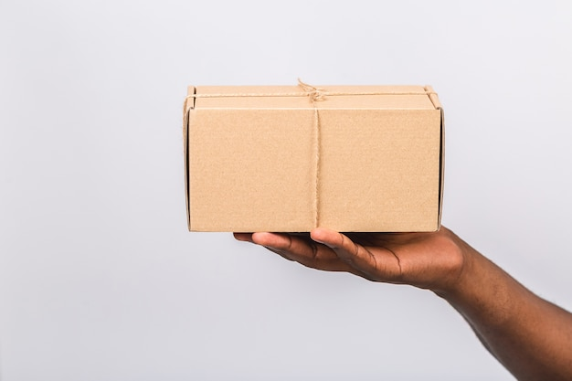 Close up of man's hand holding box isolated