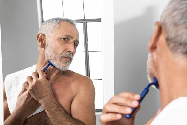 Close-up man shaving cream