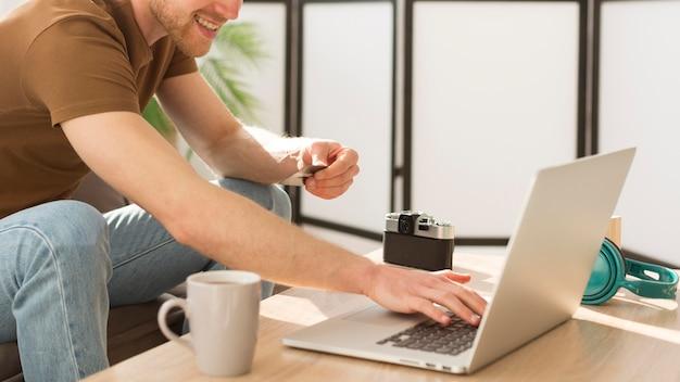 Close-up man shopping online