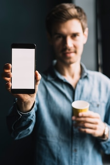 Close-up of a man showing cellphone with white screen display