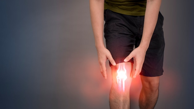 Close up man showing knee pain