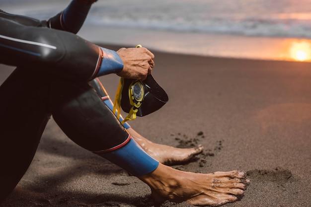 Close-up man sitting on beach
