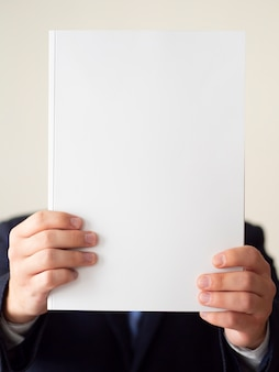 Close-up man in suit with notebook