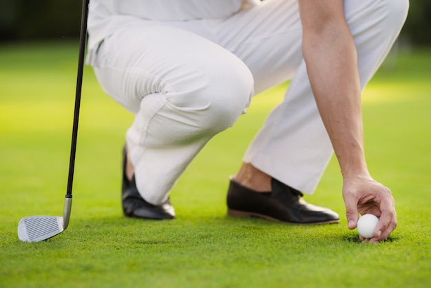 Close up. a man takes out a ball from the hole