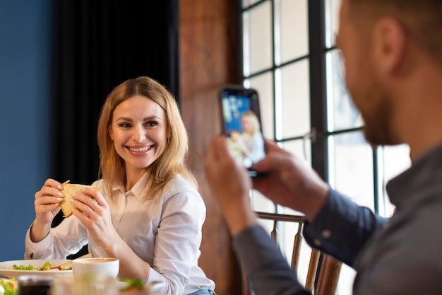 Close up man taking photos of woman