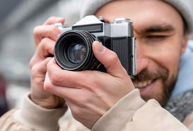 Close up man taking photos