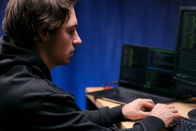 Close up man typing on keyboard