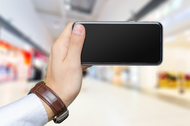 Close up of a man using mobile smartphone