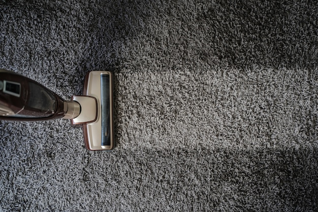 Close-up of man  using a vacuum cleaner professional vacuum cleaner