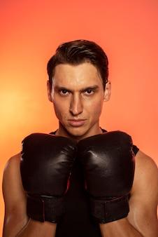 Close up man wearing boxing gloves