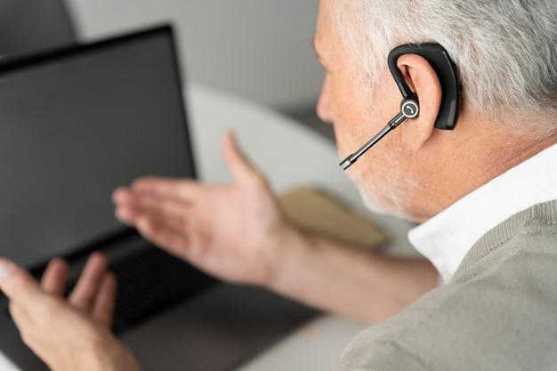 Close up man wearing earphone