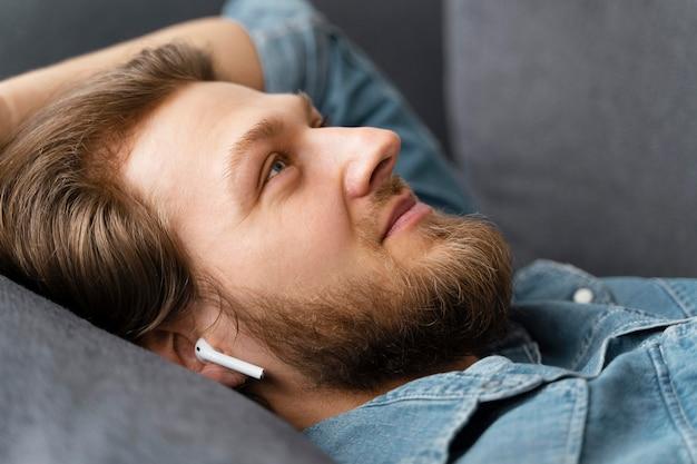 Close up man wearing earphones