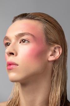 Close up man wearing make up