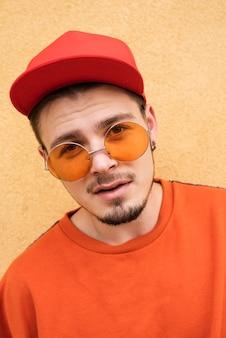 Close-up of man wearing orange