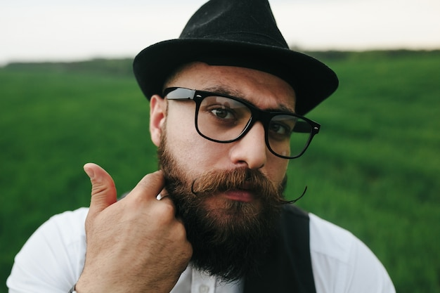 Close-up of man with beard and glasses