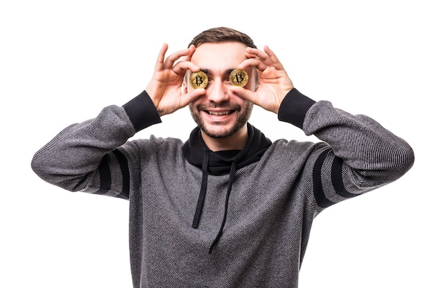 Close up of man with bitcoins in his eyes pointing fingers isolated over white