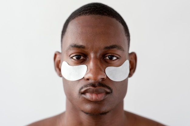 Close up man with eye patches