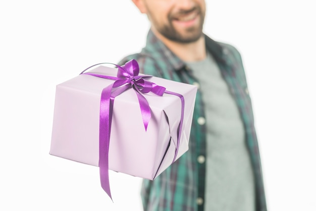 Close-up of a man with gift box