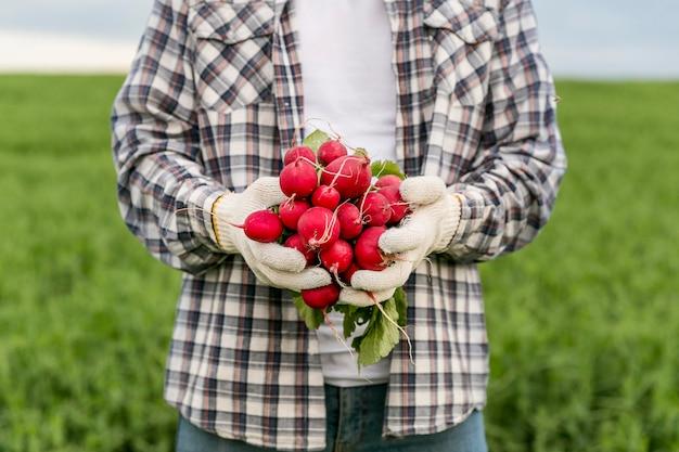 Close-up man with radish