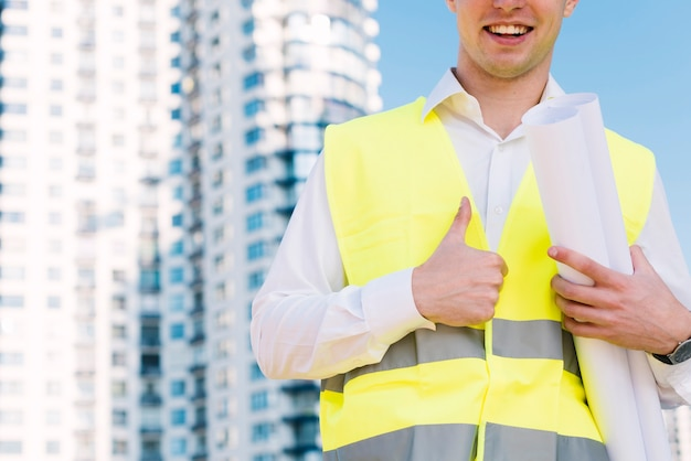 Close-up man with safety vest showing approval
