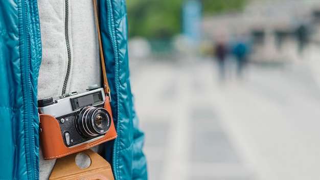 Close-up man with vintage camera