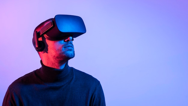 Close-up man with vr glasses and copy-space
