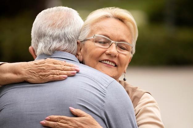 Close up man and woman hugging