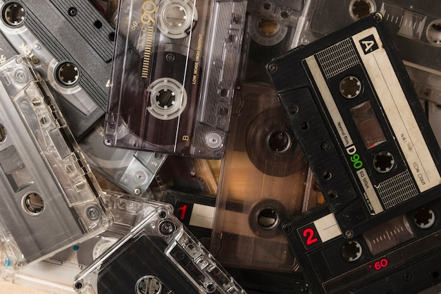Close-up of many audio cassette tapes