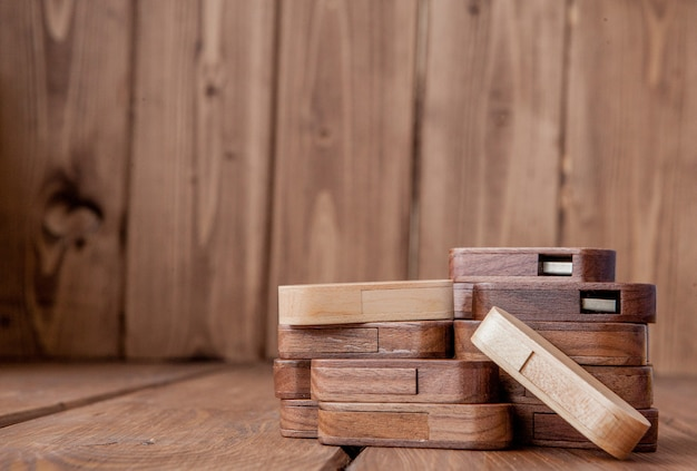 Close up on many wooden usb flash drives