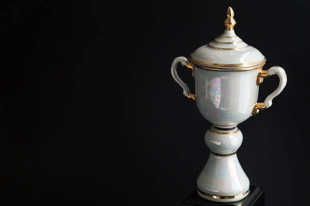 Close up of marble trophy over black background. winning awards with copy space for text and design.
