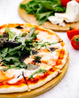 Close up of margherita pizza topped with rocket