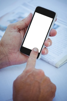 Close up of masculine hands using smartphone