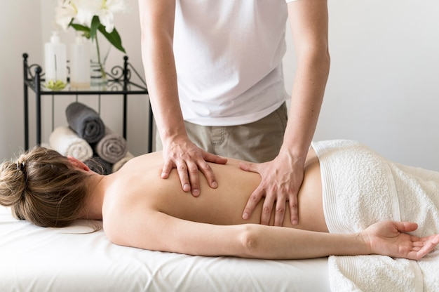 Close-up masseur working