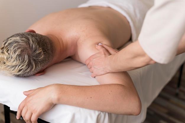 Close-up masseuse and man client
