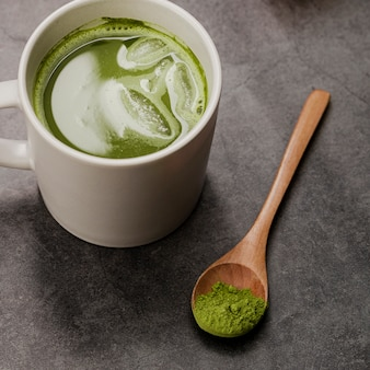 Close-up of matcha tea in cup with spoon