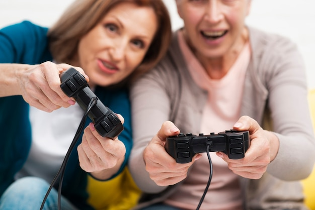 Close-up mature friends playing games