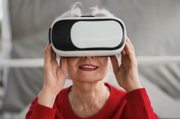 Close-up mature woman with a vr