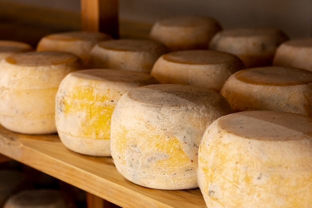 Close-up matured cheese wheels