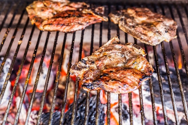 Close-up of meat grilled on barbecue grill