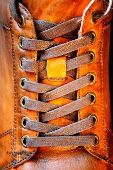 Close up of men's brown leather shoe. lacing on shoes