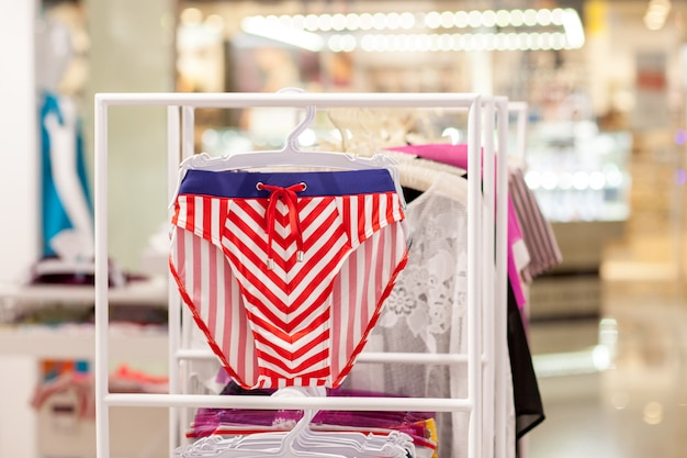 Close up men's swimming trunks in the store
