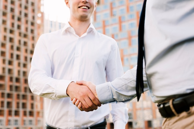 Close-up men shaking hands
