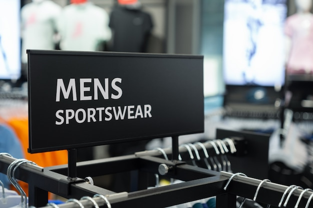 Close up of mens sportswear sign in the sports clothes shop