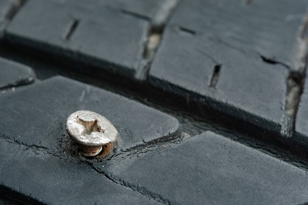 Close up metal screws nails embroidered in tires