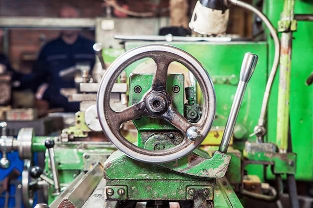 A close-up of a metallic lathe