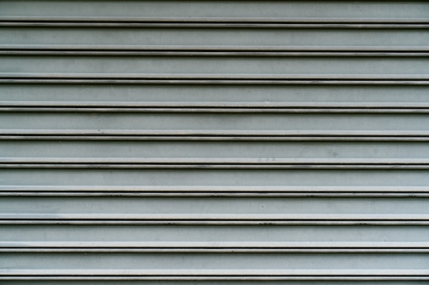 Close up of metallic roll up door surface