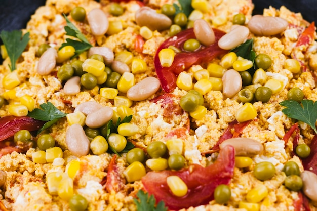 Close up mexican food with corns and beans