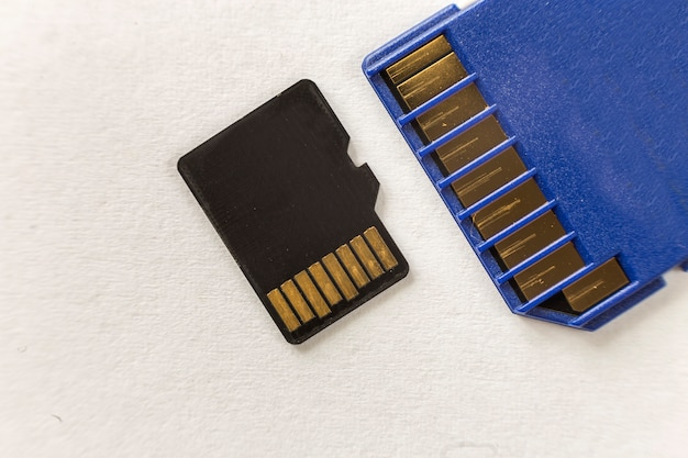 Close-up of micro sd memory card and sd adapter